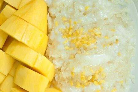 Thai style dessert, mango and sweet rice with coconut milk and nut. photo