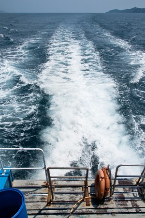 Island of sothern Thai sea, view form back of boat photo