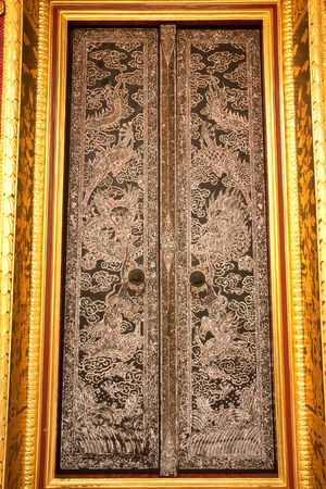 Door of Buddhist church, pieced with pieces of oyster shell Stock Photo - 4596863