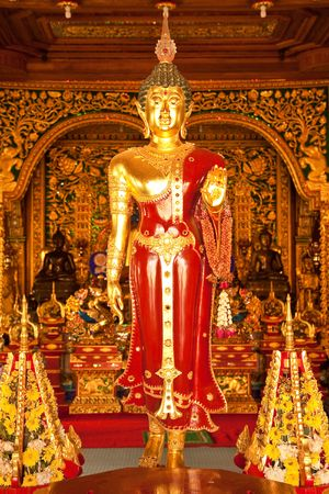 Buddha image in church of Wat Ming Maung, Chiang Rai, Thailand  photo