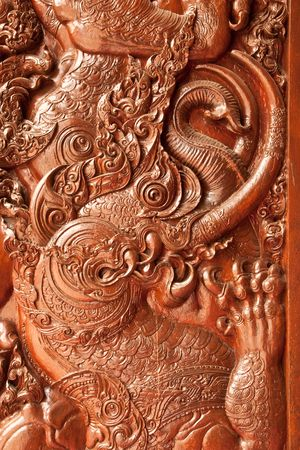 Wood carving, door of  Wat Phra Sing, Chiang Rai province, Thailand photo