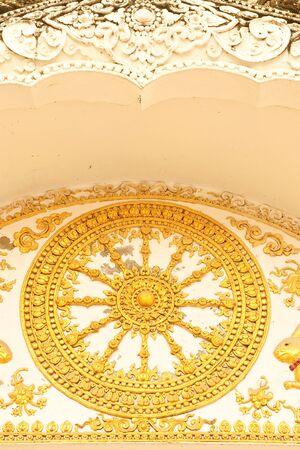 Wheel of Dhamma, symbol of Buddhism Stock Photo - 4664754