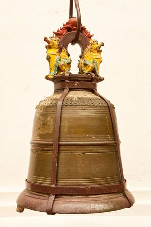 Brass bell in Thai style photo