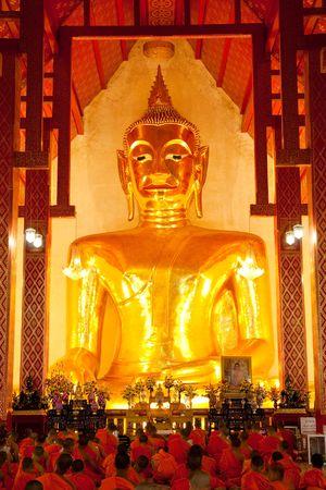 Buddha image in church of Wat Si Koam Kam, Payao province, Thailand photo