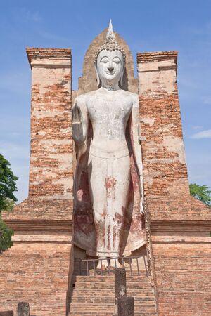 ruination: Buddha image in Sukhothai historical park, Thailand