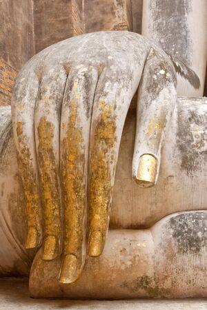 ruination: Hand of Buddha image in Sukhothai historical park, Thailand