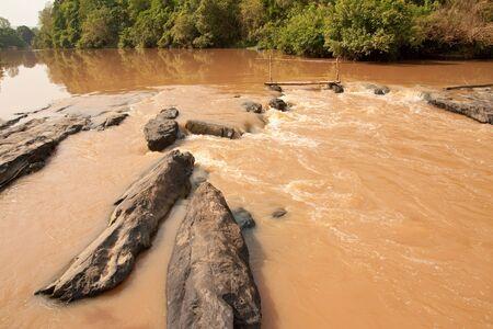 flood area: Small handmade bridge across flood area, Thailand