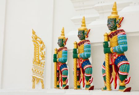 a cudgel: Giant guardians in Wat Pachayatikaram, Bangkok, Thailand Stock Photo