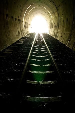 Light of the end of train tunnel