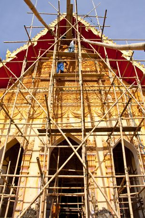 The repairing of old church of Wat Mahathat, Nakorn Panom province, Thailand photo
