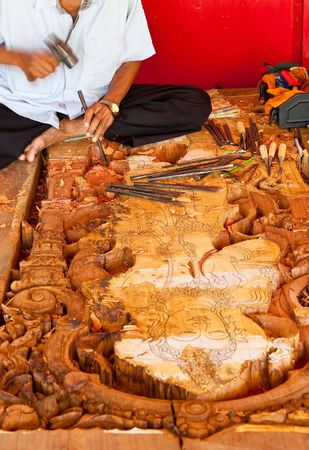 thaiart: Carpenter is carving door of church in traditional Thai style