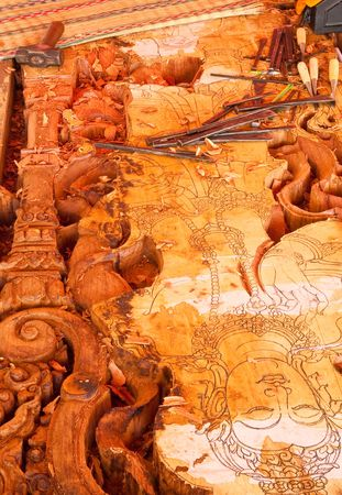 Making of wood carving church door in traditional Thai style photo