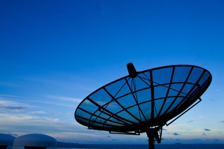 Satellite dish with morning sky Stock Photo