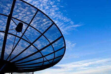 snoop: Satellite dish with morning sky Stock Photo