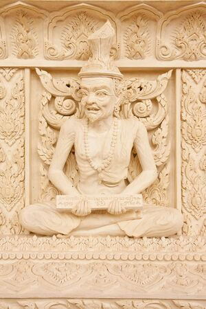 Ascetic statue in Thai style molding art photo