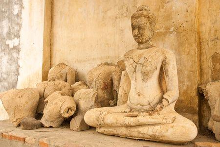 Broken Buddha statues, Thailand photo