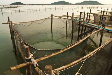fishing scene: Wood bridge to fisherman house in sea, Yor island, Thailand Stock Photo