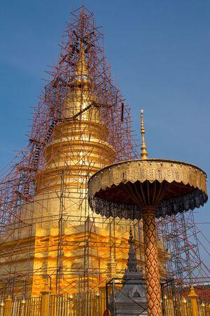 Repairing of famous pagoda, Wat Phra Thai Hariphunchai, north of Thailand photo
