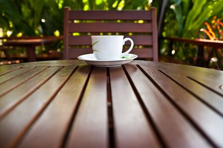 Coffee cup on wood table photo