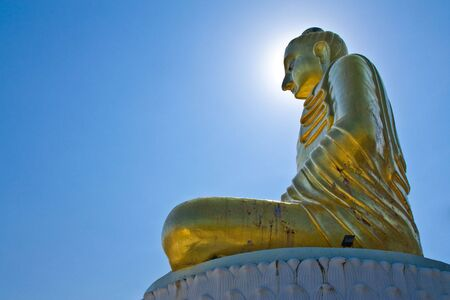 Buddha statue with sunlight on background photo