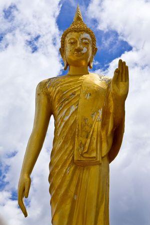 Standing Buddha statue photo