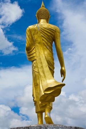 buddha face: Standing Buddha statue