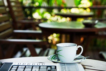 work break: Coffee cup and notebook keyboard