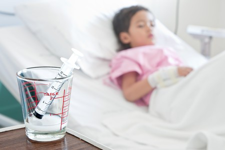 Young boy in hospital bed Stock Photo