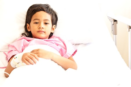 Young boy in hospital bed photo