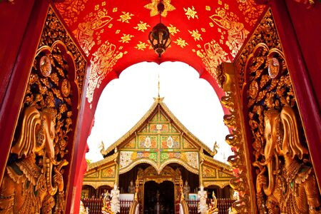 Door of Buddhist church in Thai style photo
