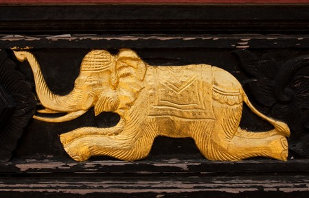 Elephant in native Thai style wood carving photo