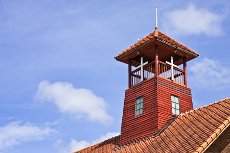 Tower on roof of old church in north of Thailand photo