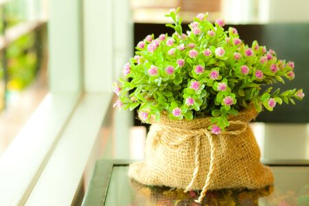 Artificial flower in lovely sack photo