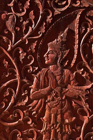 native Thai style wood carving on church photo