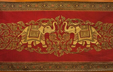 thai silk: Native Thai style cloth pattern. This is generic style in Thailand. No any tradmark in this photo.