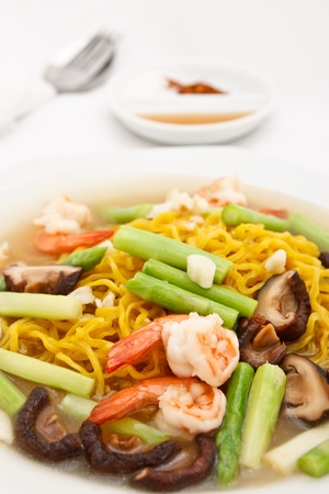 Chinese style food, yellow noodle fried with prawn and vegetables photo