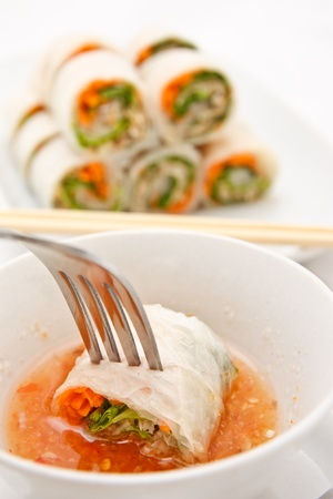 dipping: Vietnamese style food, vegetable rolled with white noodle Stock Photo