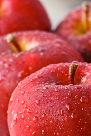 Drop of water on red apples