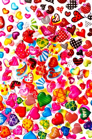 Colorful hearts on white background photo