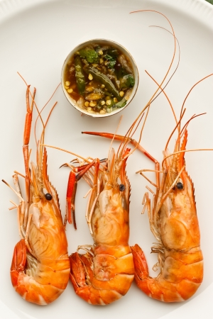 Colorful grilled prawns and Thai style sauce photo