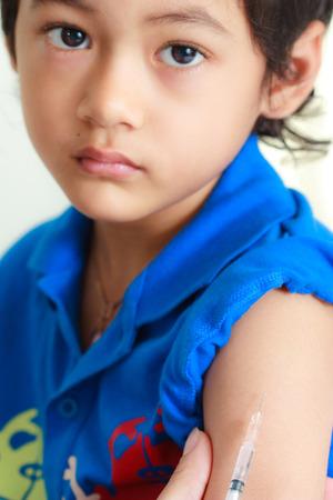 ฺDoctor give injection for boy photo