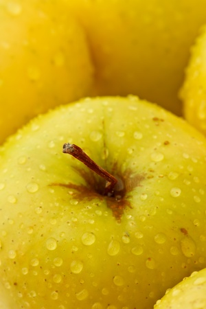 Drop of water on green apple photo