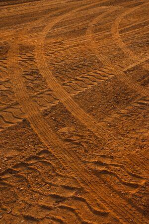Wheels tracks on red soil Stock Photo - 10214118