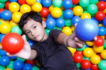 Asain boy and colorful balls