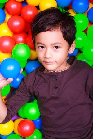 Asain boy and colorful balls photo