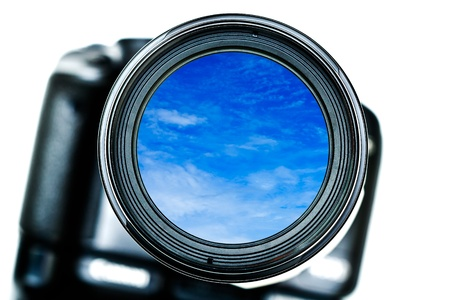 Camera lens and blue sky inside photo