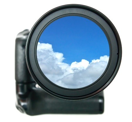 Camera lense and blue sky inside photo
