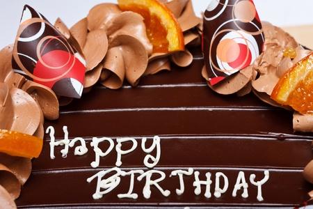 Las palabras felices de nacimiento en la parte superior de la torta de cumpleaños Foto de archivo - 11539530