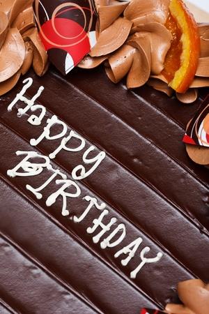 Happy Birth words on top of birthday cake