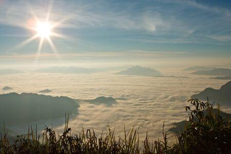 Sunlight over mist in valley photo